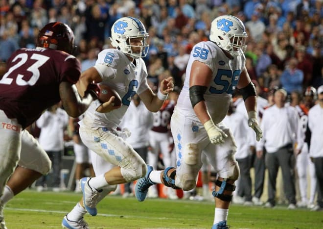 A guard for four years at UNC, Nick Polino (58) just may be the Tar Heels' starting center this coming season.