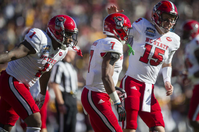 NC State's Jaylen Samuels, far left, Nyheim Hines, middle, and Ryan Finley celebrated during the Wolfpack's 52-31 victory over Arizona State last Friday in the Sun Bowl.