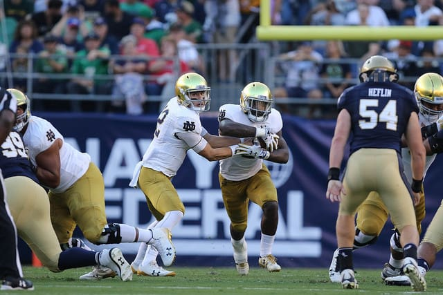 Ian Book completed 27 of 33 passes for 330 yards and two touchdowns for the Irish, while Dexter Williams carried 23 times for 142 yards and three scores.