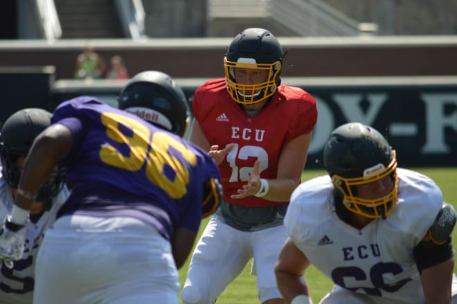 Holton Ahlers takes a snap in Saturday's first stadium scrimmage of this year's ECU fall football camp.