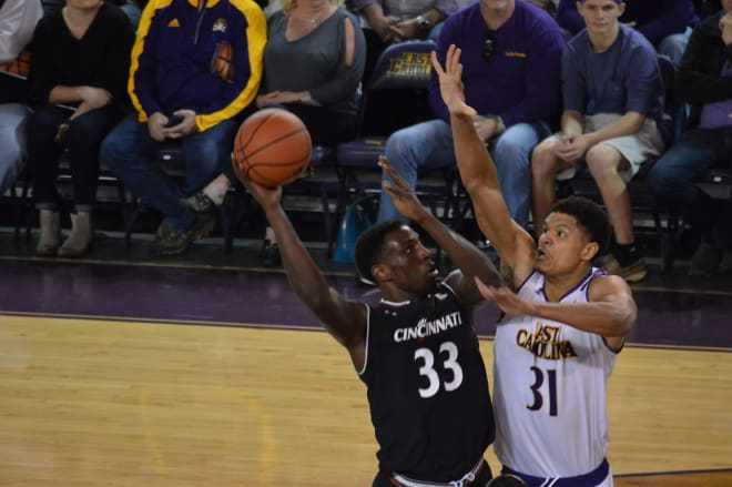 Cincinnati's Nysier Brooks shoots over ECU's Andre Washington in the Bearcats' 55-46 victory.