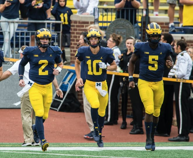 Michigan Wolverines football's Shea Patterson (left), Dylan McCaffrey (middle) and Joe Milton