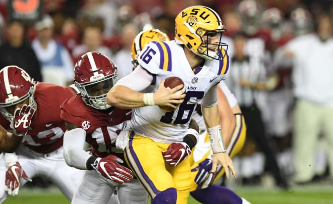 LSU Tigers quarterback Danny Etling (16) gets sacked by Alabama Crimson Tide defensive back Ronnie Harrison (15) for a loss during the second quarter at Bryant-Denny Stadium. Photo | USA Today