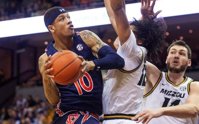 Samir Doughty (10) attacks the basket during Auburn at Missouri.