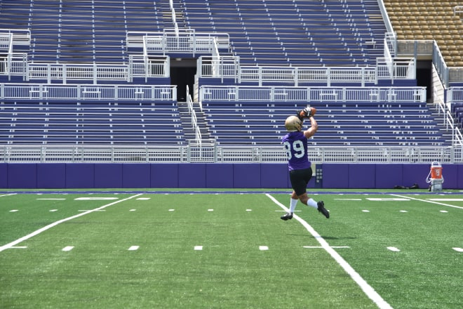 James Madison wide receiver Jake Brown leaps to make a catch during Dukes practice this past Friday at Bridgeforth Stadium.