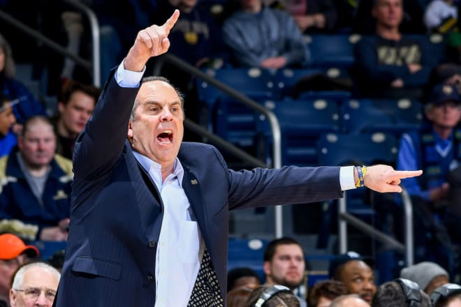 Virginia holds off Notre Dame for overtime win