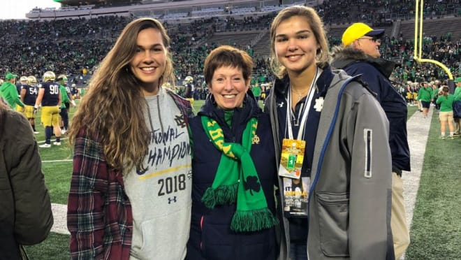 Maddie and Kathryn Westbeld with Muffet McGraw at a Notre Dame football game