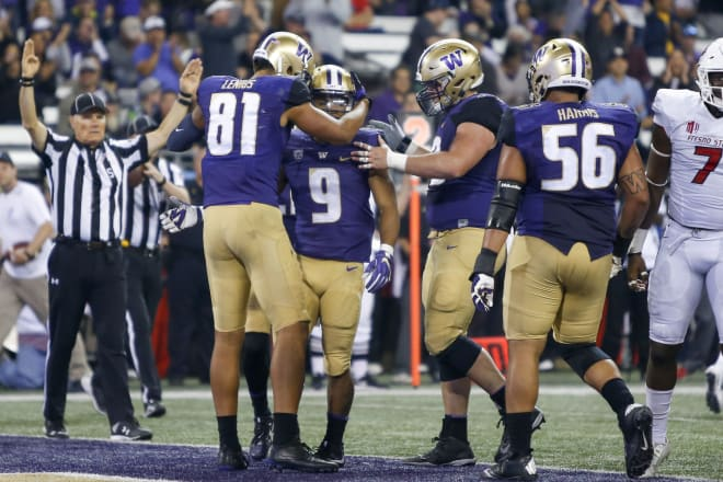 Washington Huskies running back Myles Gaskin (9) is congratulated by wide receiver Brayden Lenius (81) and offensive lineman Coleman Shelton (79) after catching a touchdown pass against the Fresno State Bulldogs during the second quarter at Husky Stadium. Photo Credit: Joe Nicholson-USA TODAY Sports