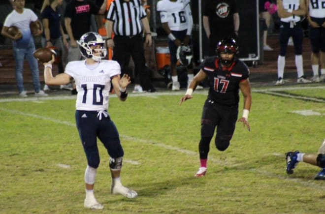 Pinnacle quarterback JD Johnson surveys the field and gets ready to deliver a pass in Friday's game at Liberty.  Johnson completed 15-of-25 passes for a season-best 324 yards.  It was also the third time this season he has thrown four touchdowns in a game.