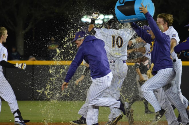 Brady Lloyd is doused after his game winning bunt got (7)ECU past Campbell 4-3 Tuesday night in Greenville.