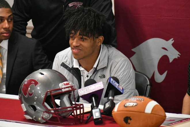 John Emery Jr. sits at the front of Destrehan's banquet room on Signing Day on Dec. 19, 2018