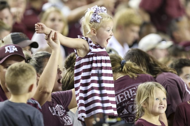 A young cult member celebrates an Aggie sacrifice at a recent bonfire/bloodletting.