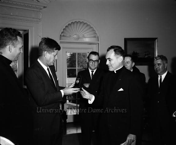 Father Ted Hesburgh presents President John F. Kennedy the Laetare Medal on Nov. 22, 1961.