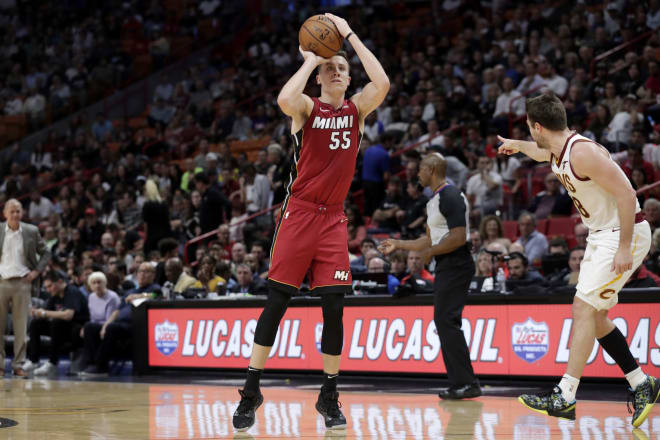 Former Michigan Wolverines head basketball coach John Beilein looks on (left) as his former player Duncan Robinson (middle) had 29 points for the Heat against the Cavs.