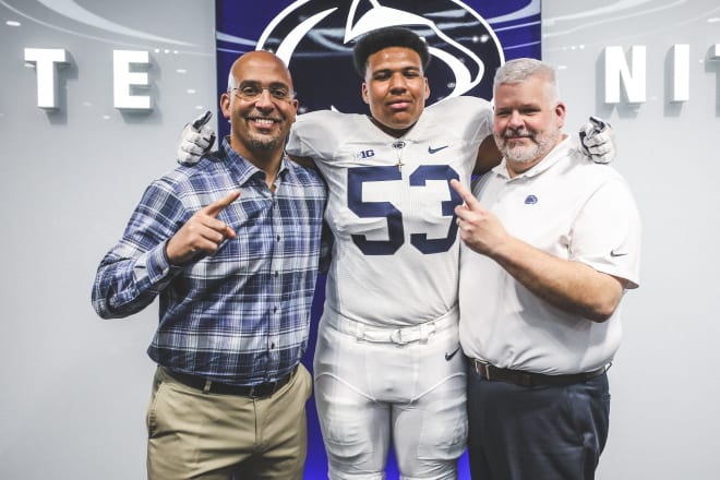 Dawkins poses with Penn State head coach James Franklin and offensive line coach Matt Limegrover during a recruiting visit.