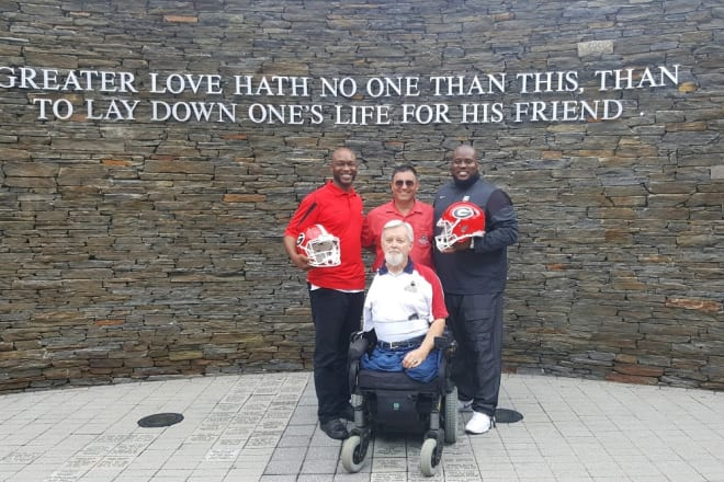 Rodgers and Tommy Clack pose with former Georgia standouts Corey Allen (left) and Travis Stroud (right) at the Walk of Heroes Veteran War Memorial.