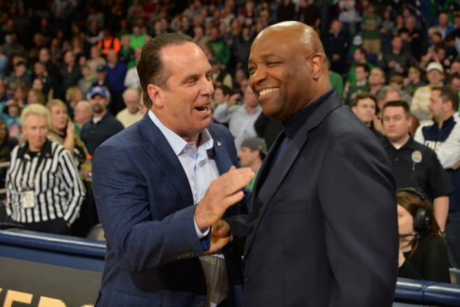 Leonard Hamilton talks with Notre Dame's Mike Brey before their game earlier this season.