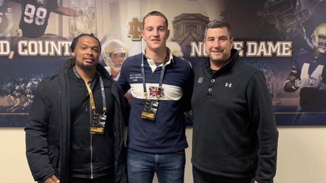 Alexander Ehrensberger (center) committed to Irish defensive line coach Mike Elston (right) and the Notre Dame program from his native Germany.