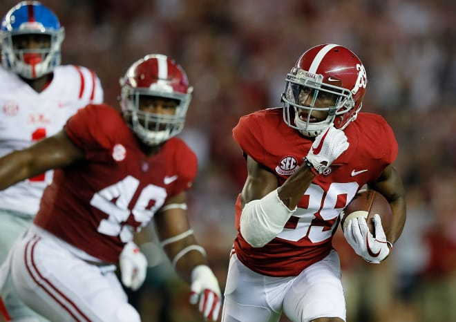 Alabama cornerback Levi Wallace returns an interception for a touchdown against Ole Miss. Photo | Getty Images