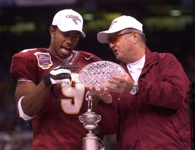 Peter Warrick and Bobby Bowden celebrate the Seminoles' 1999 national championship.