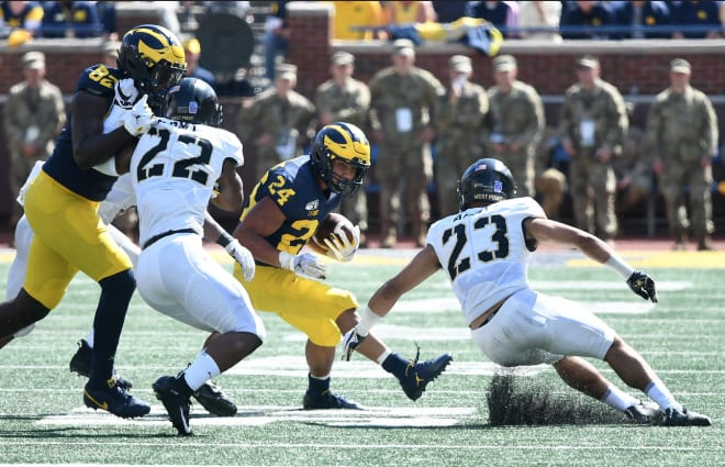Michigan Wolverines football freshman running back Zach Charbonnet became the first U-M freshman to receive 33 carries in a game AND rush for 100 yards since Mike Hart in 2004.