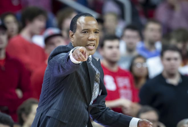 NC State Wolfpack basketball coach Kevin Keatts points.