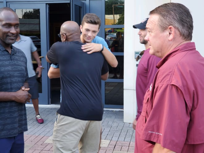 QB Kade Renfro is greeted by FSU's coaches when he returned to campus Sunday morning.