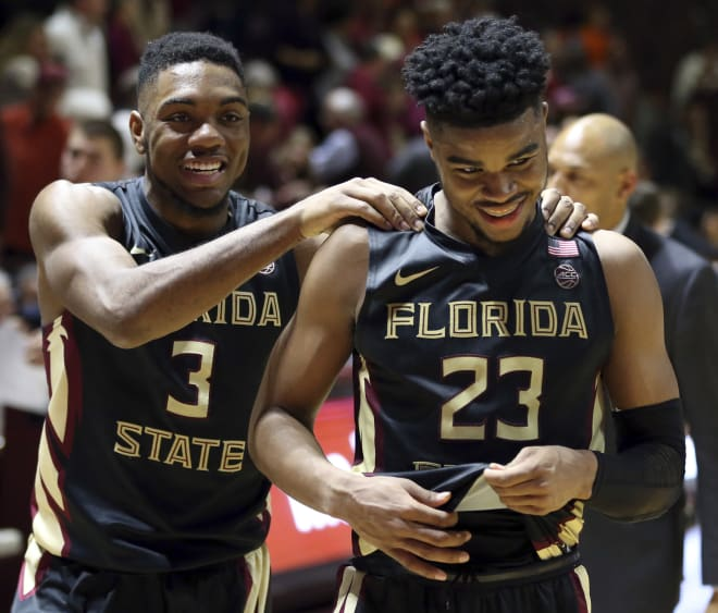 FSU freshman M.J. Walker (No. 23) celebrates with teammate Trent Forrest after his 24-point performance Saturday.