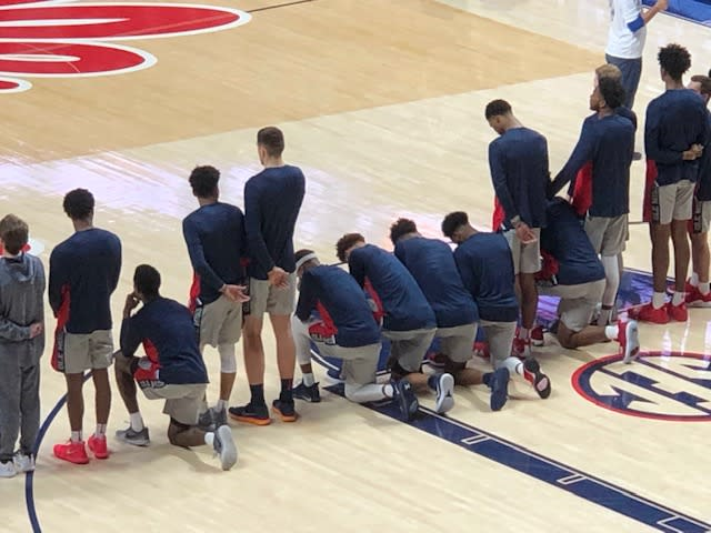 Ole Miss players kneel during the national anthem prior to the Rebels' 72-71 win over Georgia.