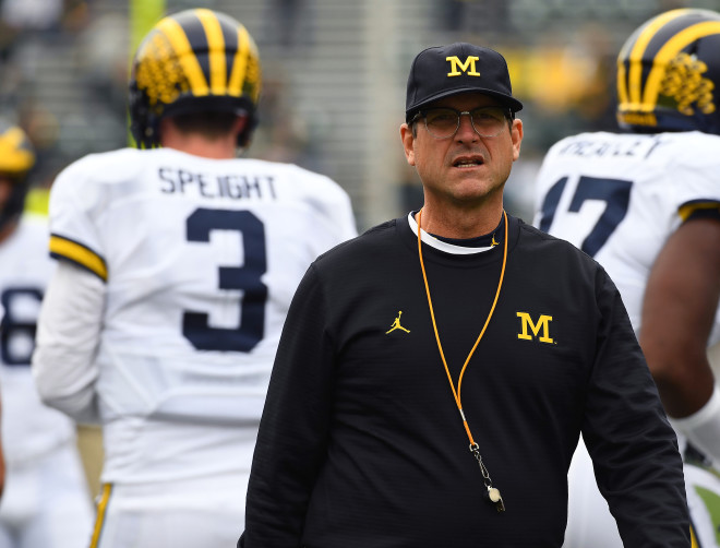 Big Ten reprimands Michigan coach Jim Harbaugh for criticizing officials, fines school
