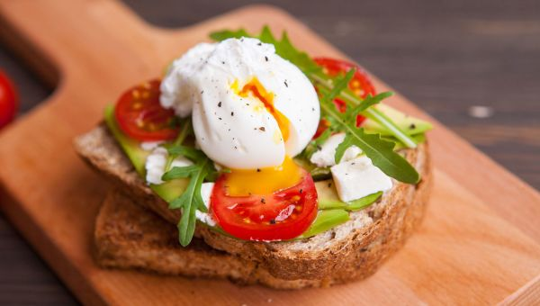 Avocado, egg and tomato sandwich
