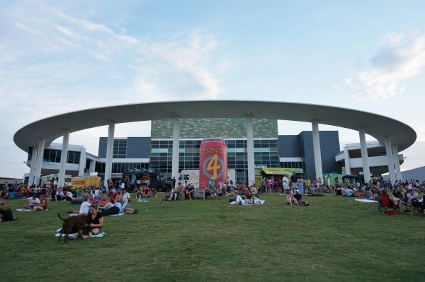 Crowd gathers on the lawn of the Long Center for Trailer Food Tuesdays