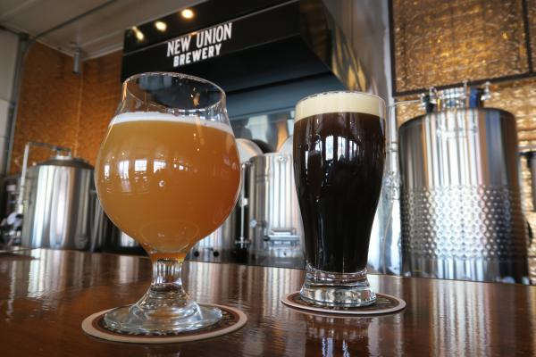 Glasses of Flat River Imperial IPA and Main Street Chocolate Stout and New Union Brewery