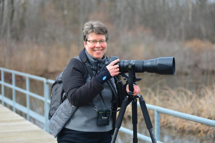Jan Lewis at Reeds Lake looking for birds