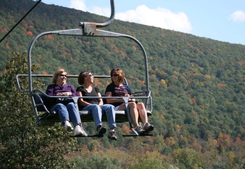 finger-lakes-bristol-mountain-canandaigua-fall-sky-ride-three-women-in-chair