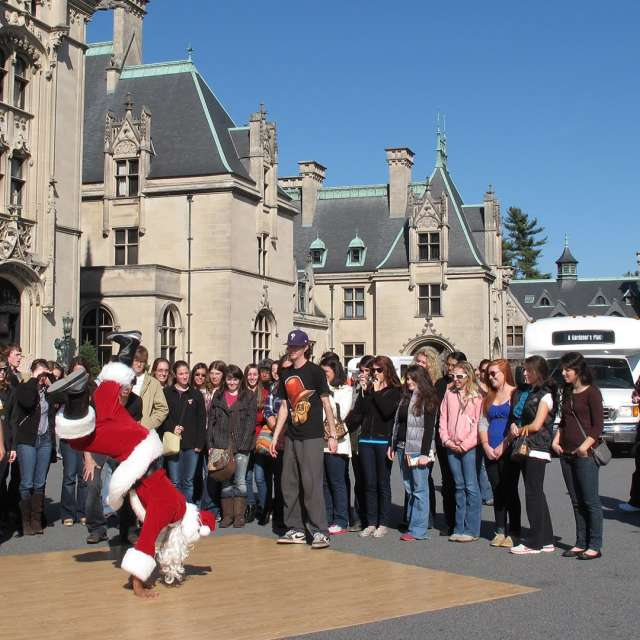 Video Thumbnail - youtube - Dancing Santa - B-boy Santa Sneak Attack in Asheville, NC