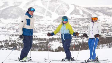 Three skiers enjoying the slopes in the Geilolia area in Geilo