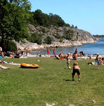 People enjoying a sunny day at the beach