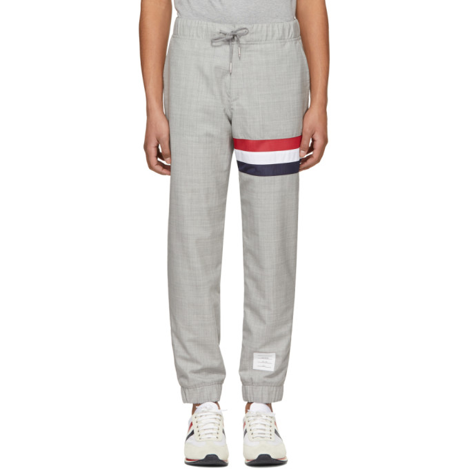 SWEATPANTS WITH SEAMED IN RED, WHITE AND BLUE STRIPE IN
