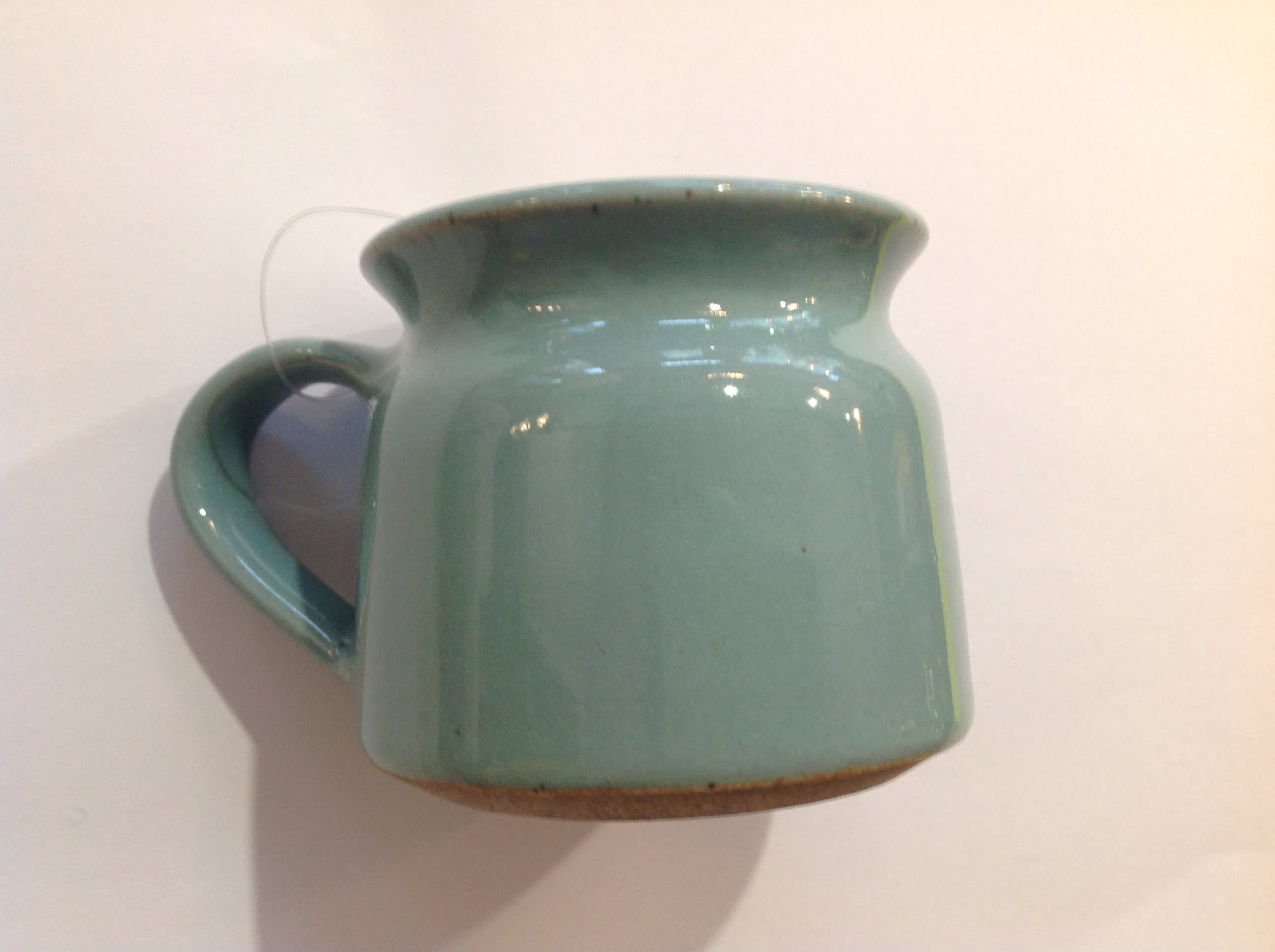 New Overseas Traders Handmade Fairtrade Mug In A Mint Green Colour with a green inside