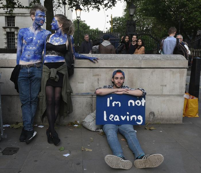 Protesters, including a young couple painted as EU flags, outside Downing Street in London after voters opted to leave the EU following the referendum. Picture: Mary Turner/Getty Images