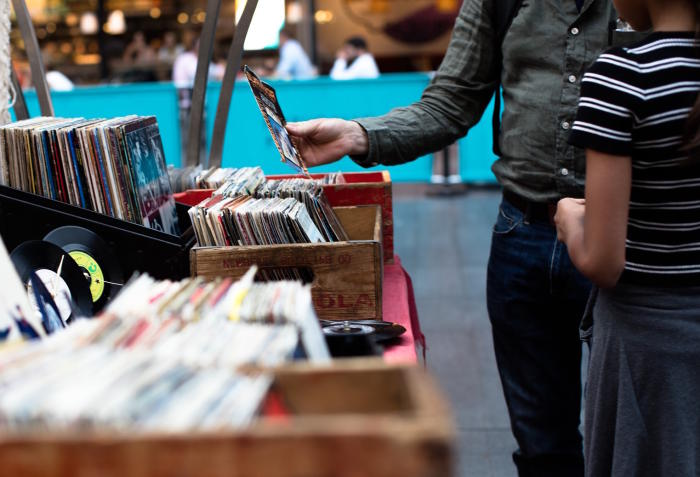 Taking time to indulge in a simple pleasure like browsing old vinyl records may actually help to fortify us psychologically to make progress on our goals. Picture: Pixabay
