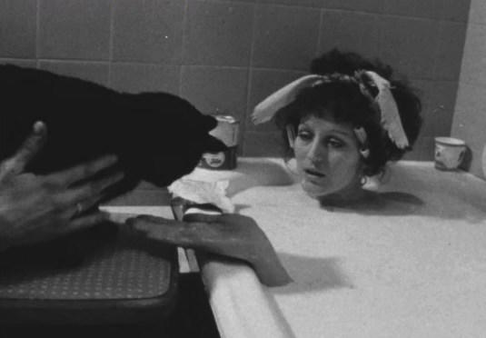 Germaine Greer introduces a cat to the bathtub of milk in Nice Time. Picture: Supplied
