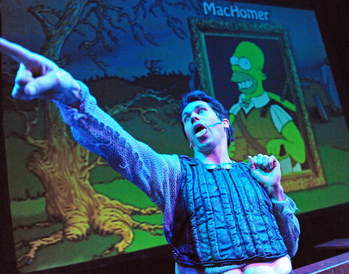 Canadian actor and comedian Rick Miller performs a scene from his play MacHomer. A one-man show, MacHomer is based on Macbeth and recreated with more than 50 characters from The Simpsons. Picture: Torsten Blackwood/AFP/Getty Images