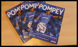 Pompey v Wigan Programme from 2009 signed by Michael Brown