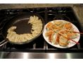 nonstick 12-Inch Turbo Fry Pan & uniformly browned cooked pot stickers (TPA1004C)