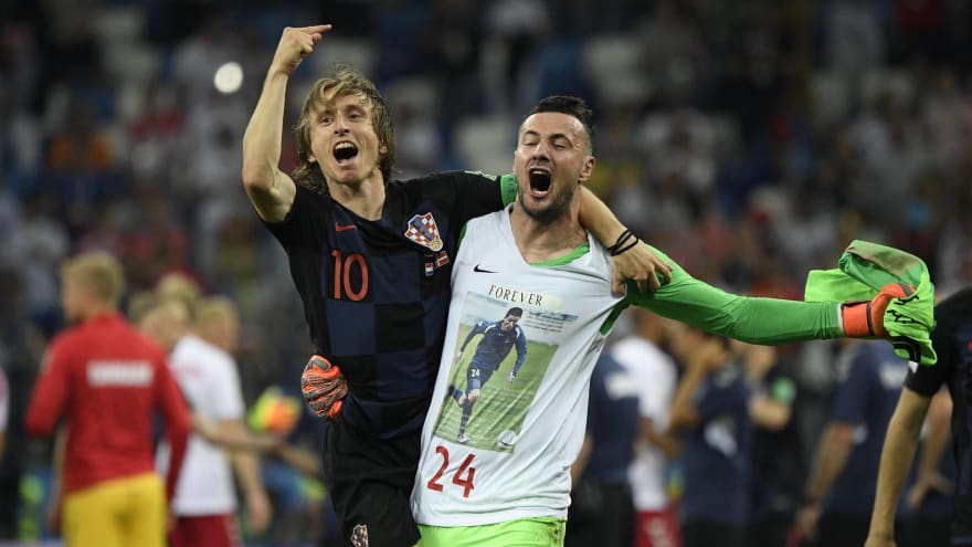 941200a99 Croatia's Luka Modric (L) and goalkeeper Danijel Subasic celebrate victory  after the 2018 FIFA World Cup round of 16 match between Croatia and Denmark  in ...