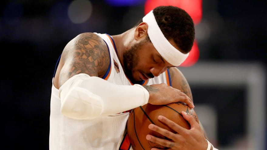 86ca4c0b1d1a Carmelo Anthony of the New York Knicks hugs the ball before the opening  tipoff against the Philadelphia 76ers at Madison Square Garden on April 12